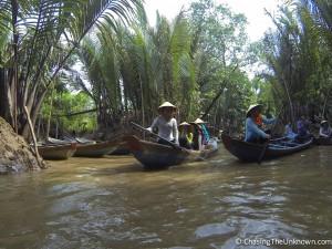 Taking a sampan down the Mekong.