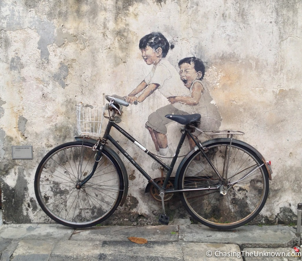 Kids on Bicycle street art George Town