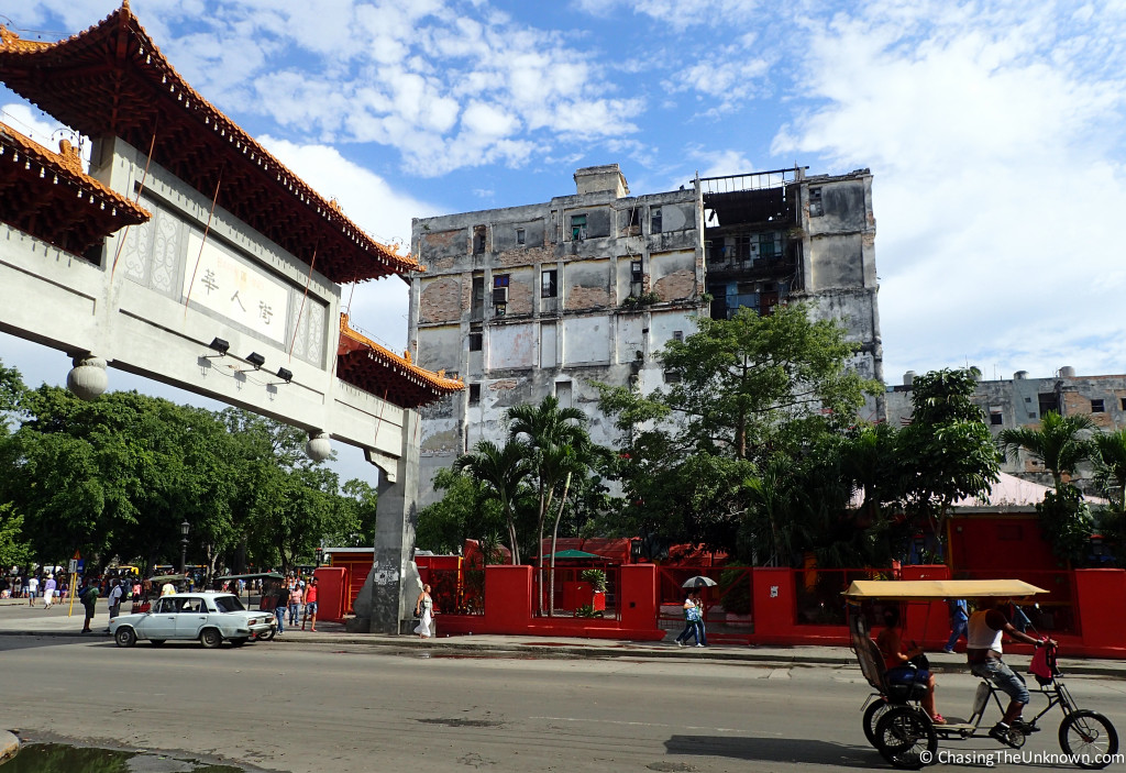 Crumbling buildings like this one near Havana's Chinatown gate are a common sight.